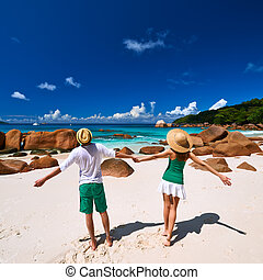 Couple in green on a beach at Seychelles - Couple in green...