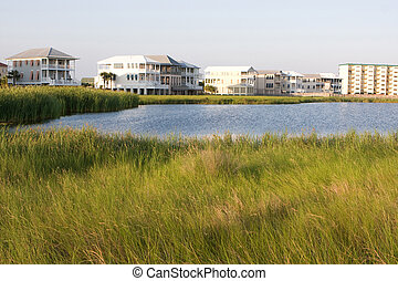 Homes Encroach On Wetlands - Luxury high-end vacation homes...