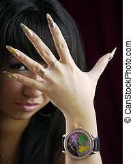 Art nail design. Portrait of a young brunette with long nails.