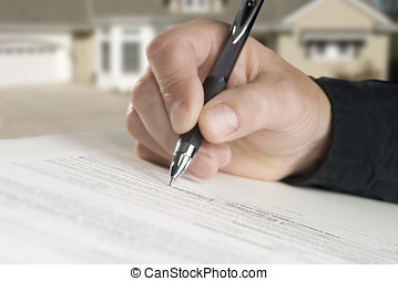 please sign here - man signing paperwork, new home in...