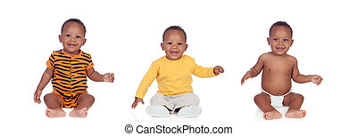 Three equal african babies with differents clothes isolated...