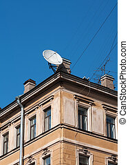 Satellite dish on background of an old house - Satellite...