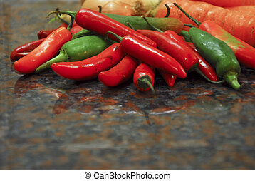 Jalapeno peppers - red and green jalapeno peppers with...