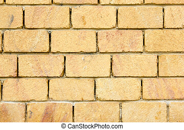 Yellow brick wall close up front view