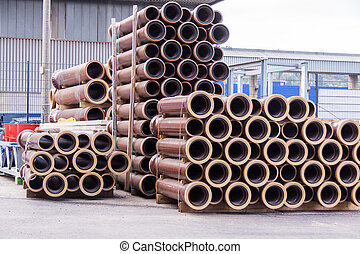 Plastic pipes in a factory or warehouse yard - Plastic pipes...