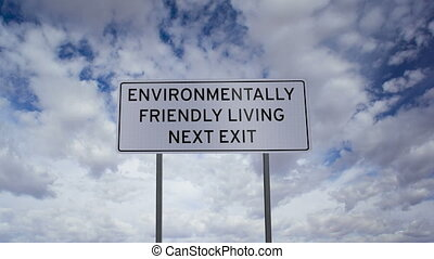 Environmentally Friendly Living Sig - Highway road sign with...