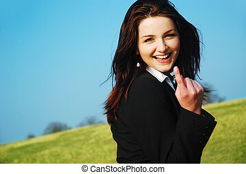 Come with me! - A beautiful young businesswoman leading the...