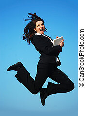 Businesswoman jumping - A beautiful young businesswoman...