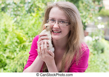 girl with a small chicken