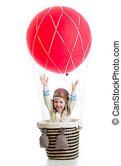 happy kid on hot air balloon with hands up