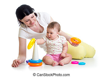 kid girl and mother playing together with toy