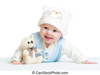 smiling baby weared hat with plush toy
