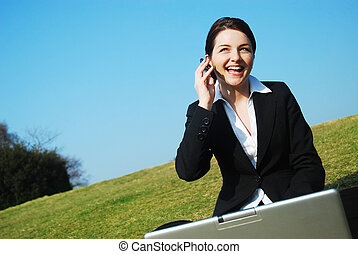 Happy Businesswoman at work Outdoors - A beautiful young...