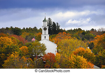 Church surrounded by autumn colors - White country church...