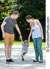 Couple playing with child - Young couple playing with child...