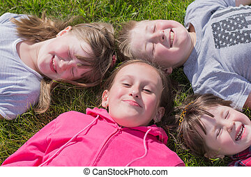 four children on the grass, outdoors