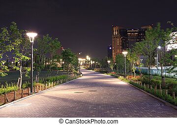 beautiful garden walkway with lamps at night, Odaiba, Japan