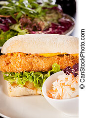 Burger with golden crumbed chicken breast - Closeup of a...