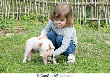 piglet in girls  - White piglet in girls hands smiling