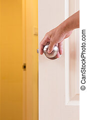 Man hand locking door knob