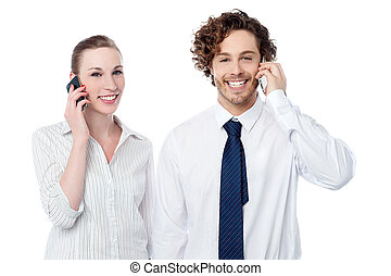 Business people communicating thru mobile phone - Smiling...