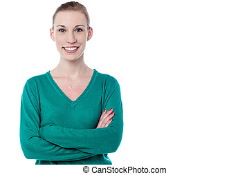 Confident woman in casuals with arms crossed