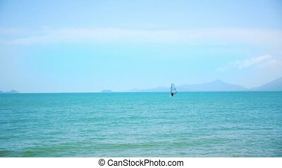 Windsurfing on a Clear Day in a Blue Sea. Thailand. Koh...
