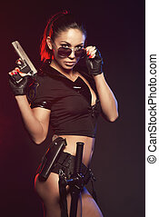 Sexy woman with police uniform in studio on dark red and...