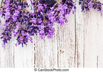 Fresh lavender on the white shabby wooden table