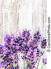 Fresh lavender on the white shabby wooden table with copy...