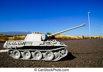 Modern War Concept Model Tank in the Middle of an Asphalt...