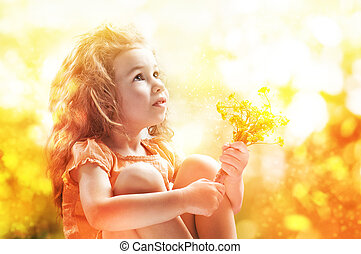 sunny day - child enjoys a sunny day