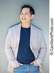 Modern asian man smiling