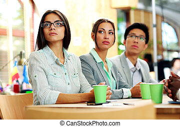 Business people sitting at the table during a meeting in office