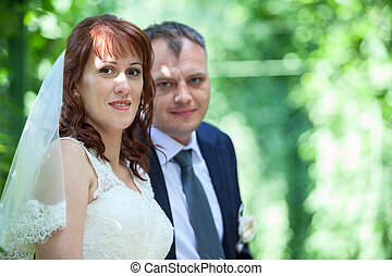 Head and shoulders portrait of young wedding couple