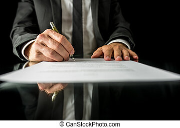 Signing legal papers - Front view of businessman signing...