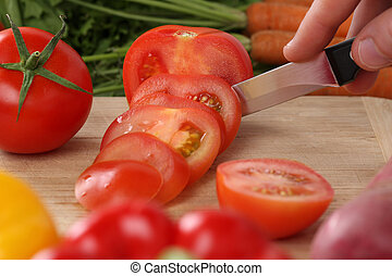 Preparing vegetables food sliced tomato on a kitchen board