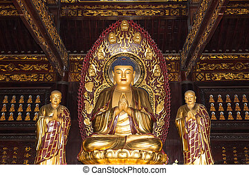 Buddhist Temple. Golden statue of Buddha-- southern Xian...