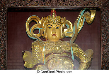Buddhist Temple Golden statue of Buddha-- southern Xian...