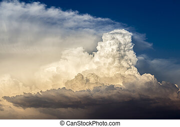 Storm clouds bathed in sunset light - Dramatic cumulonimbus...