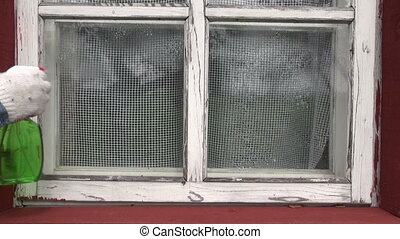 cleaning old window in farm