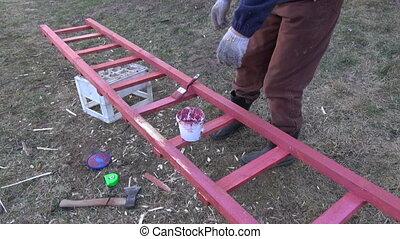 gardener paint in red new ladder