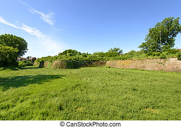 green dry moat of Cittadella, Alessandria, Italy - view of...