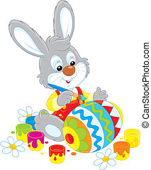 Bunny paints an Easter egg - Little rabbit coloring a big...