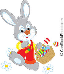 Easter Bunny with a basket of eggs - Little rabbit walking...