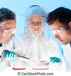 Life scientist pipetting. - Focused young life science...