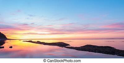 Panorama of ocean beach at the crack of dawn - Panorama of...