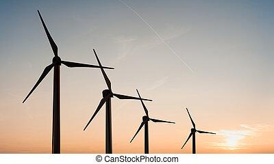wind turbine - Silhouette of wind turbine in sunset sky