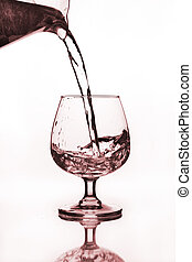 water jug pouring to wine glass
