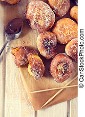 Sweet mini donuts from above on the wooden table